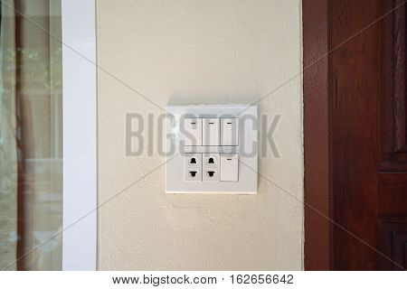 light switch with socket on the wall