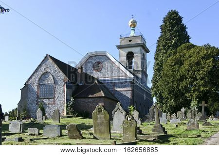 flint walled church on hilltop in west wycombe buckinghamshire uk
