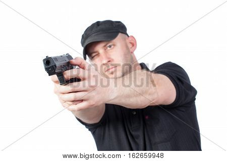Man pointing gun isolated on white. Focus on the gun