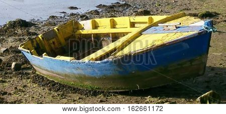 Shipwreck stranded on the border of a the sea