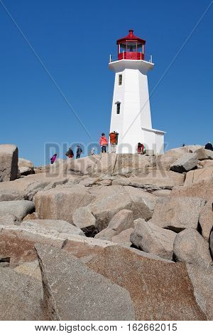 Nova Scotia Canada - september 28 2015: Big rocks in front of the famous lighthouse of Peggy's Cove Nova Scotia Canada