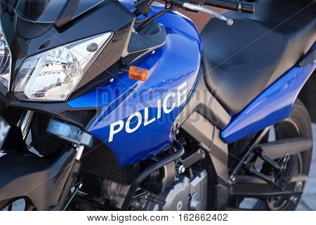 Blue modern police motorcycle on the street