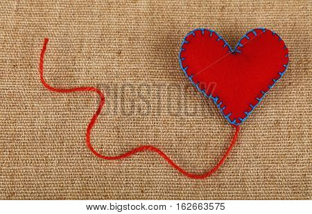 Red Felt Craft Heart Over Canvas Close Up