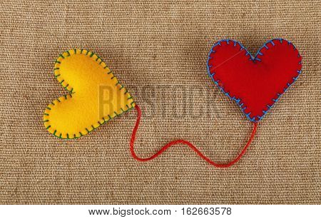 Two Felt Craft Hearts, Yellow And Red On Canvas