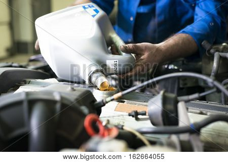 Car servicing, oil and filter replacing maintenance