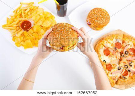 Hands Holding Hamburger Or Cheeseburger