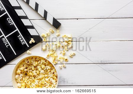 watching movie with popcorn on wooden background top view.