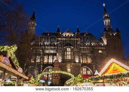 AACHEN / GERMANY - NOVEMBER 22, 2016: Illuminated Christmas market near the City Hall in the evening