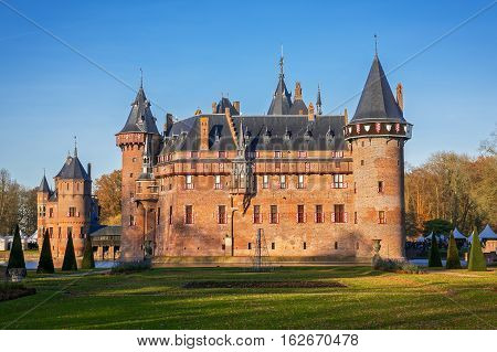 View of the medieval castle  De Haar from the park in the fall, The Netherlands