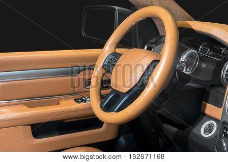 Modern car interior dashboard, orange leather interior