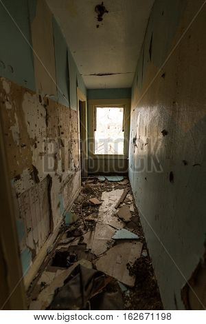 Trashed hallway of an abandoned old house