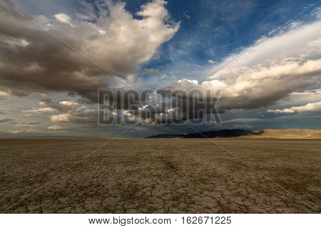 Big Puffy Clouds Over A Parched Desert Landscape