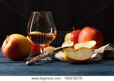 Glasse Of Calvados Brandy And Red Apples