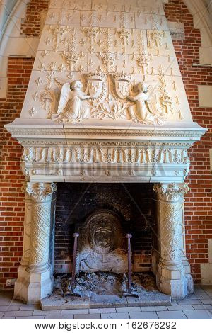 CASTLE OF AMBOISE, AMBOISE, FRANCE - CIRCA JUNE 2014: The fireplace in interior of the Amboise Castle in circa June, 2014. Amboise is chateau in the town of Amboise in the Loire valley, UNESCO World Heritage Site.