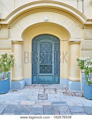 Athens Greece elegant house arch entrance with flowerpots