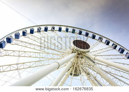 Chicago IL USA october 28 2016: Gondolas move passengers via hub of the newly opened Dutch Ferris Wheel with baseball tema Cubs logo in the centre