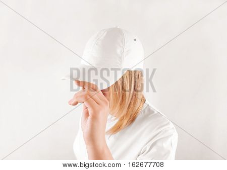 Blank white baseball cap mockup template wear on women head isolated side view. Woman in clear hat and t shirt uniform mock up holding visor of caps. Cotton basebal cap design on delivery guy.