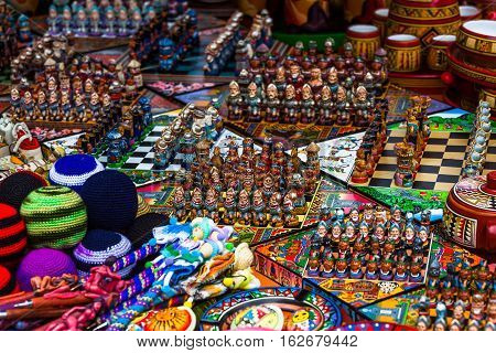 Chess games made with figures representing Spaniards and Indians in the Indian market of Otavalo