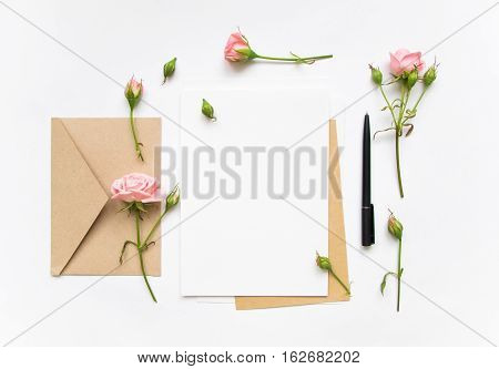 Letter And Eco Paper Envelope On White Background. Invitation Cards, Or Love Letter With Pink Roses.
