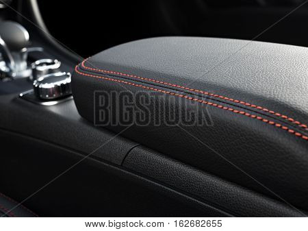 Modern sport car interior with focus on red stitch