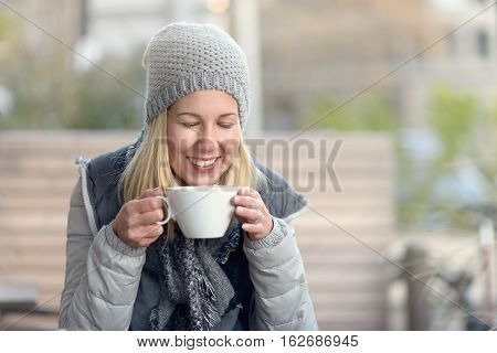 Smiling Happy Woman Enjoying Hot Coffee