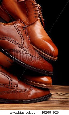 Four Toes One On One Of Brown Shoes Brogues And Derby On The Wooden Table.shoes Shine Concept Of Lux