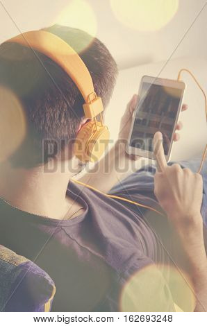 Back view of a man with headphones. Selective focus.