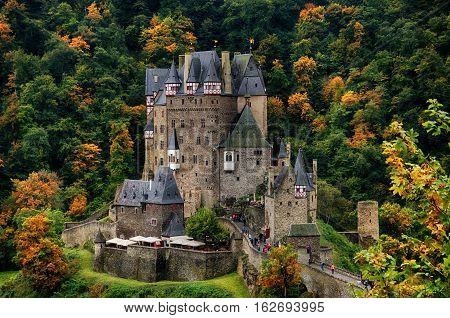 Castle Eltz in Germany. Against the backdrop of the forest.