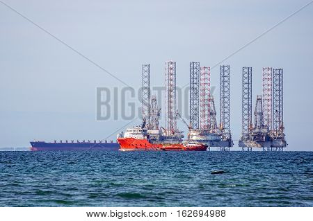 Labuan,Malaysia-Dec 22,2016:The supply vessel & Jack up rig in Labuan island.Labuan being strategically located in the hub of Asia-Pacific & in the ASEAN offshore oil exploration & production region.