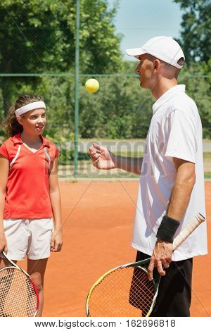 Tennis Instructor And Teenage Student