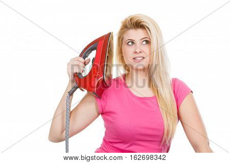 Woman Holding Iron Close To Head