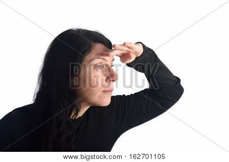 Woman looking with hand on forehead on a white background color