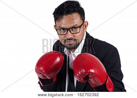 Business man ready to fight with boxing gloveson white background