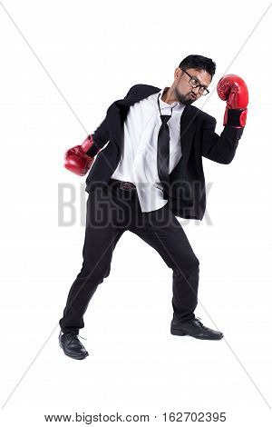 Business man ready to fight with boxing gloves on white background