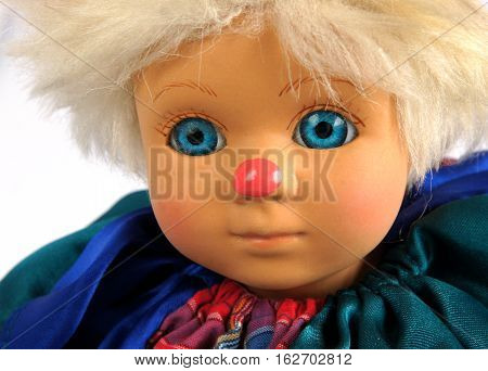 Closeup face of vintage puppet clown on white