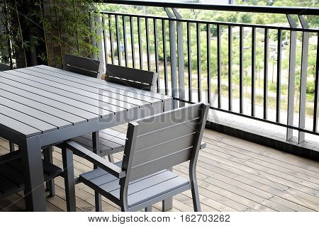 fragment with wooden furniture on cozy terrace