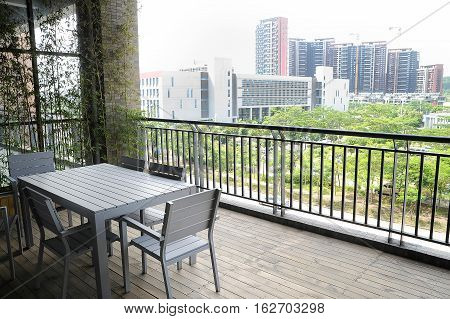 View on city from comfortable wooden terrace