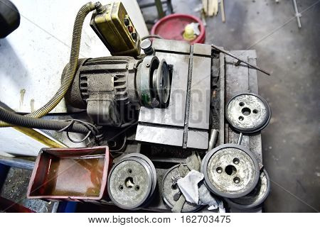 Old grungy obsolete but still functional motor