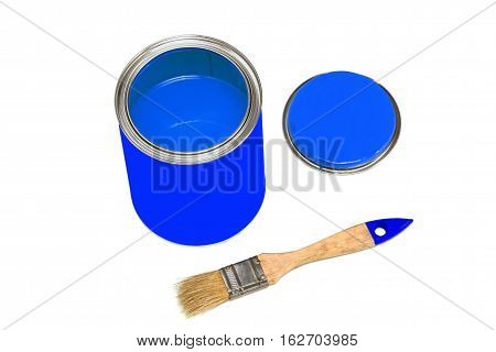 Bank of blue paint and paintbrush isolated on white background.