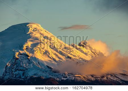 Antisana volcano at sunset, like a gold mountain
