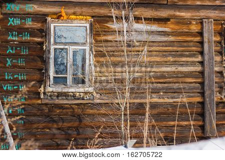 Window rustic hut in the cold. Unfinished rustic hut in the winter.