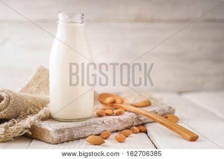 Almond milk almond nuts napkin on a stand horizontal