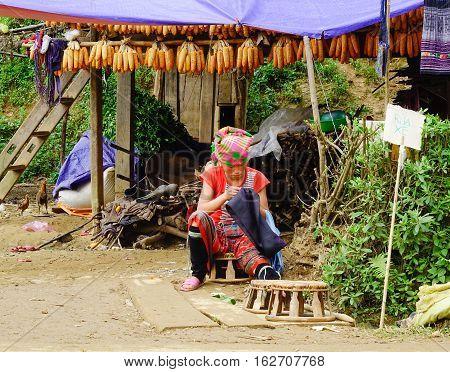 Hmong Woman Sewing In Sapa, Vietnam