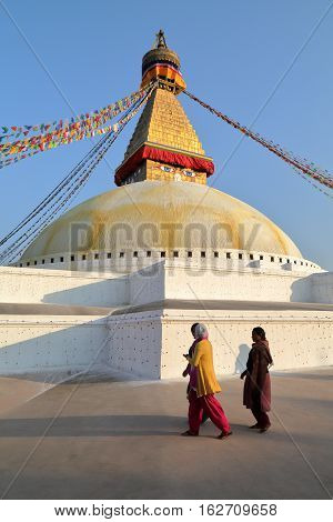 BODHNATH, NEPAL - DECEMBER 22, 2014: Two Nepalese Women at the Bodhnath Stupa near Kathmandu