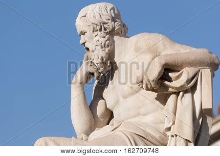 classical statue of Socrates from side, sky