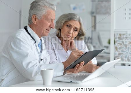 Portrait of a doctor and famale patient in office