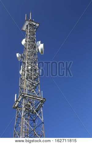 Telecommunications Tower In Front Of A Dark Blue Sky