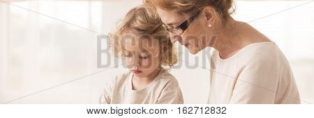 Elderly Nanny With Little Boy