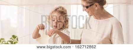 Boy Cutting Cookies With Grandma