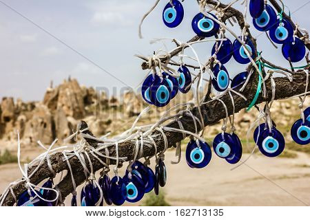 Traditional blue evil eyes. Tree with popular Turkish souvenir.